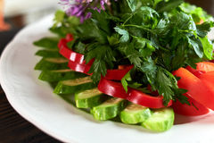 Fresh salad of tomatoes, cucumbers, peppers, arugula and dill jpg Royalty Free Stock Photo