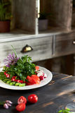 Fresh salad of tomatoes, cucumbers, peppers, arugula and dill jpg Stock Photos