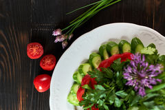 Fresh salad of tomatoes, cucumbers, peppers, arugula and dill jpg Stock Photography