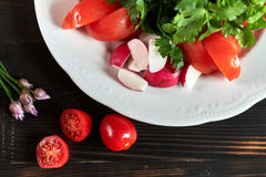 Fresh salad of tomatoes, cucumbers, peppers, arugula and dill jpg Royalty Free Stock Photos