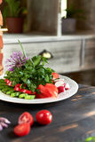 Fresh salad of tomatoes, cucumbers, peppers, arugula and dill jpg Stock Photo