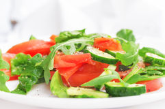 Fresh salad with tomatoes, cucumbers and spinach Stock Images