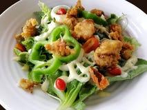 Fresh salad tomatoes and mixed greens arugula, mesclun, mache close up. Healthy food. stock photo