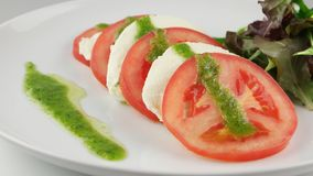 Fresh salad with tomatoes, mozzarella and arugula stock footage