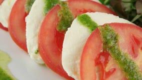 Fresh salad with tomatoes, mozzarella and arugula stock video footage