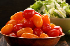 Fresh salad with tomatoes on wooden background Stock Image