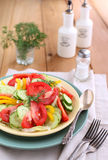 Fresh salad with vegetables. Served with forks Stock Photography