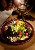 Fresh salad and vegetables on a clay plate royalty free stock images
