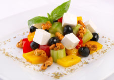 Fresh salad with vegetables, feta and nuts Royalty Free Stock Image