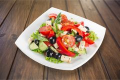 Greek salad with fresh vegetables on background royalty free stock images