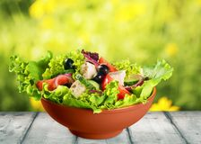 Greek salad with fresh vegetables on wooden table stock image