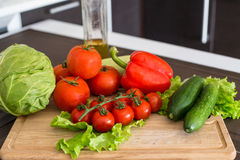 Fresh salad vegetables on the home table Stock Photography