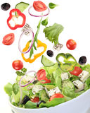 Fresh salad with vegetables in motion Stock Photography
