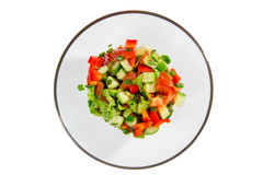 Fresh salad with vegetables tomatoes, cucumbers, lettuce, salad leaves isolated on white background Stock Photos
