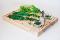 Fresh salad, vegetarian salad, cabbage on wooden board on a white background stock photo