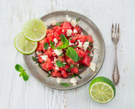 Fresh salad with water-melon, feta cheese, lime and mint. Close-up Royalty Free Stock Images