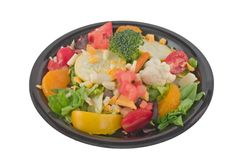 Fresh salad on white. Colorful salad plate of lettuce, tomatoes, cauliflower, broccoli, cheese on white Stock Photos