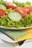 Fresh salad on white plate Royalty Free Stock Image