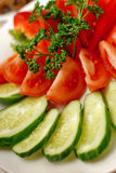 Fresh salad on a white plate Royalty Free Stock Photos