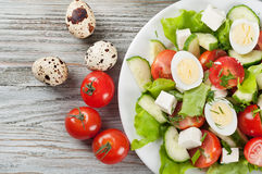 Fresh salad on a white plate Royalty Free Stock Images