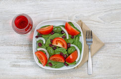 Fresh salad and wine Royalty Free Stock Images