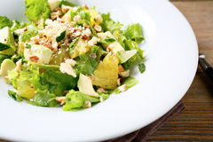 Fresh Salad With Avocado, Lettuce, Orange And Crushed Nuts Stock Photos