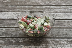 Fresh salad on a wooden table Royalty Free Stock Images