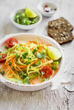 Fresh salad with zucchini and carrots in a light vintage plate Stock Images