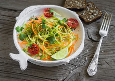 Fresh salad with zucchini and carrots in a light vintage plate Royalty Free Stock Images