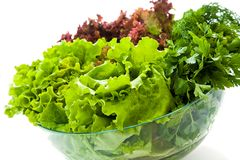 Fresh salads. Some bunches of fresh salads in a glass bowl royalty free stock image
