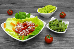Fresh salads and avocado Royalty Free Stock Photo