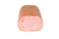 Fresh salami. Front view of a fresh salami on white background Stock Photo