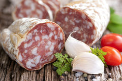Fresh salami. On wooden ground stock photo