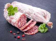 Fresh salami. On a slate royalty free stock images