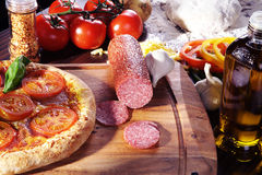 Fresh salami pizza served Stock Image