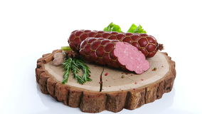 Fresh salami  sausage isolated on white background stock footage