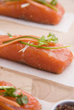 Fresh salmon. Salmon en papillote with Carrots, Courgettes and Spring Onions Stock Photo