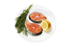 Fresh salmon. Slices of a fresh salmon lemon and fennel isolated on a white background Stock Image