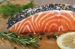 Fresh salmon. Steak sprinkle coarse ground pepper and salt Royalty Free Stock Images