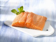 Fresh salmon. Fillet on chopping board Royalty Free Stock Photos