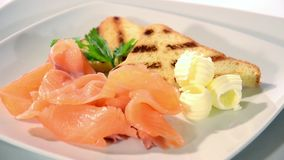 Fresh salmon appetizer. On a white plate rotating stock footage