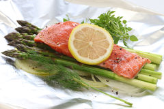 Fresh salmon with asparagus in foil Stock Images