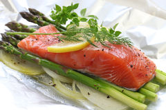 Fresh salmon with asparagus in foil Stock Image