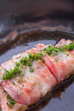 Salmon in the bacon coat Stock Photography