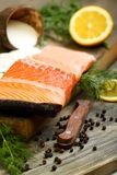 Fresh salmon with black pepper and dill. Royalty Free Stock Photos