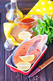 Fresh salmon. In bowl and on a table Stock Photography