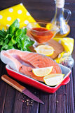 Fresh salmon. In bowl and on a table Royalty Free Stock Photo