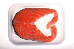 Fresh salmon in the box on a white Stock Photos