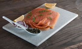 Fresh Salmon with Capers, Lemon and Greens Royalty Free Stock Photos