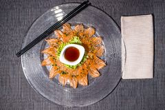 Fresh salmon carpaccio with salad and citrus fruit sauce stock images
